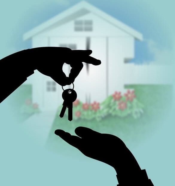 hands handing over house keys