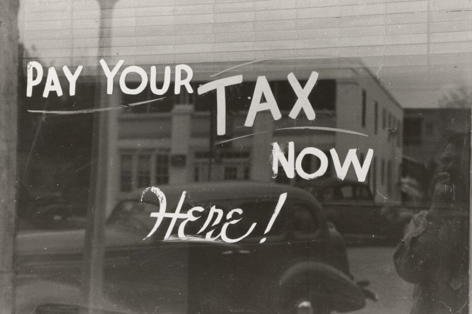 Sign that says Pay Your Tax